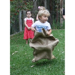 Kids hessian sack race game is one of the most favourite & classic of all kid's party games. Play the hessian sack race as a fun outdoor relay race game.